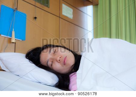 Asleep Patient On A Medical Bed