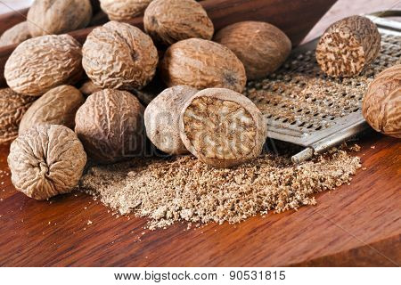 Ground nutmeg on wooden table background