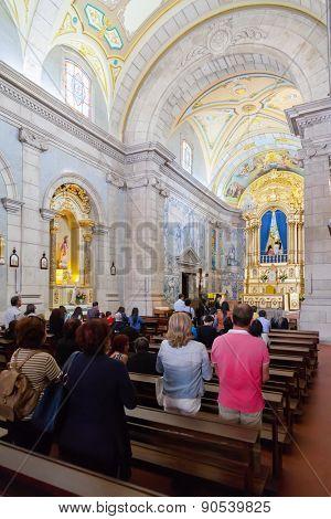 Terras de Bouro, Portugal. April 06, 2015: Faithful praying in the interior of the Sanctuary of Sao Bento da Porta Aberta. Pope Francis promoted it to Basilica in the 400th anniversary in March, 21st