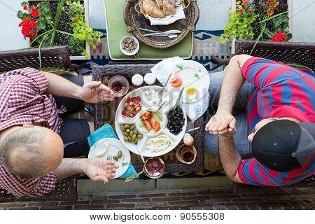 Two Multi Denominational Men Praying Over Food