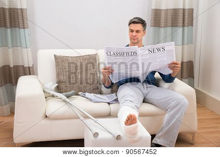 Disabled Man Reading Newspaper