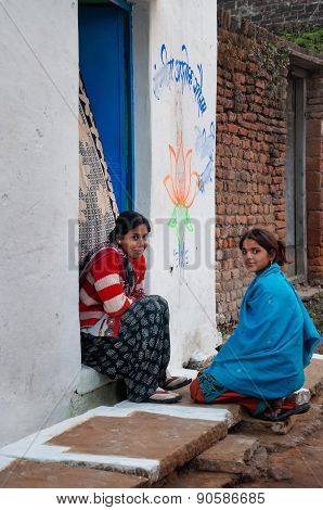 Indian Young Women Sit And Chat On A House Porch