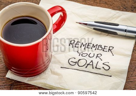 remember your goals - handwriting on a napkin with a cup of epsresso coffee