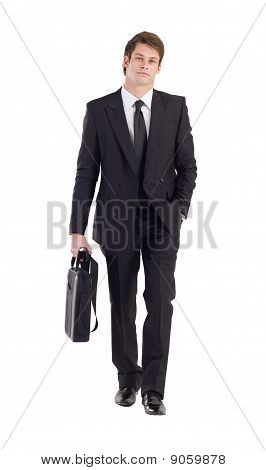 a handsome young businessman walking forward holding briefcase poster