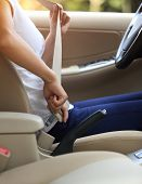 woman driver buckle up the seat belt before driving car poster