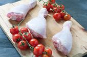 Various fresh meats of chicken and pork with tomatoes poster