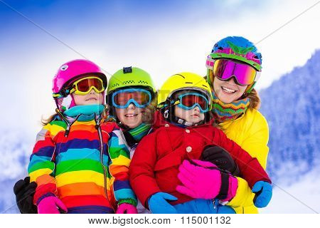 Family With Children On Winter Ski Vacation