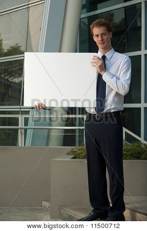 Serious Business Man Blank Sign Office Building