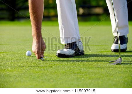 Golfer Repaired Green With Pitch Fork