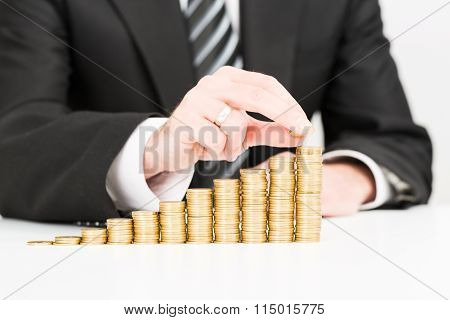 Businessman Hand Putting Money Coin Stack Growing Business.