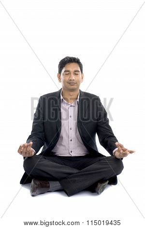 Indian Buiness Male Yoga On The Floor