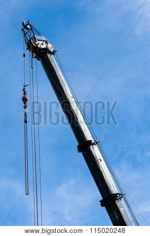 Large Heavy Industrial Crane Extended With Pulleys And Hanging Cables