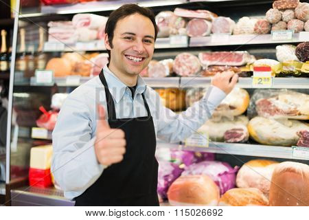 Portrait of a confident shopkeeper in a butchery