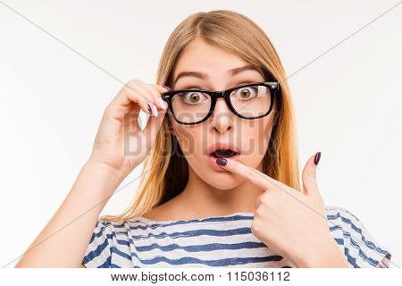 Surprised Girl In Glasses Touching Her Lips