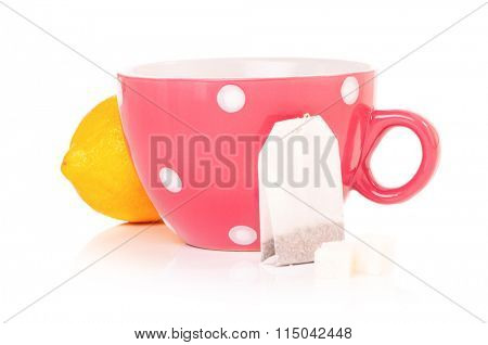 Tea cup with teabag and lemon. Isolated on white background