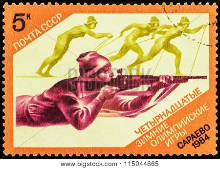 Biathlon And Running Skiers On Post Stamp