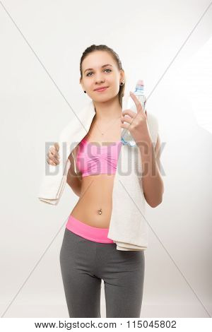 Young athletic girl finished training, holding bath towel