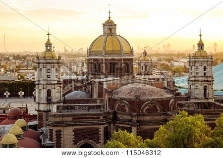 View Of Basilica Of Guadalupe With Mexico City Skyline At Sunset, Mexico