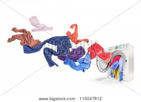Colored Laundry Flying From Washing Machine, Isolated On White Background
