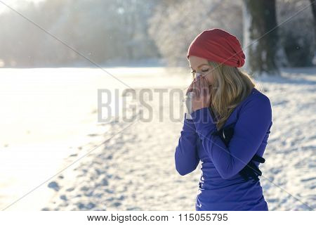 Young Woman Suffering From A Winter Cold
