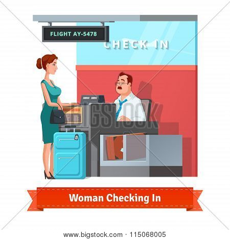 Woman checking in at the airport with clerk