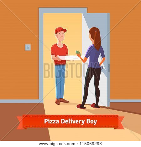 Pizza delivery boy handing pizza box to a girl