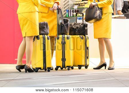 Flight Attendants At International Airport - Working Travel Concept With Women On Uniform