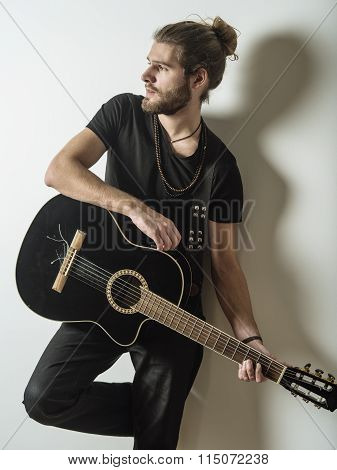 Handsome Young Man Holding Acoustic Guitar