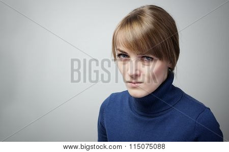 Young Woman Looking Reproachfully Into The Camera.