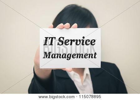 IT Service Management message on the card Held by women.