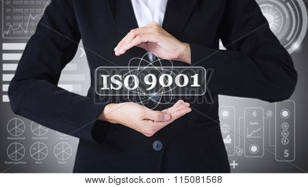 Business women holding posts in iso 9001.