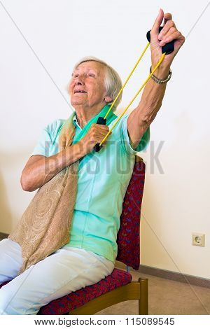 Elderly Woman Exercising Her Shoulders