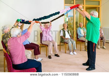 Trainer Lifting Garland For Class With Seniors