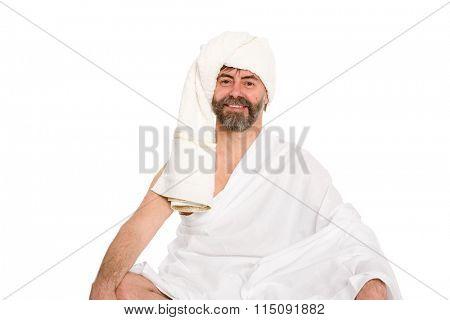 Joyful man dressed in the sauna in a turban. From a series of Russian bath.
