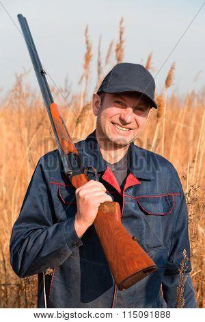 Man hunting among autumn grass