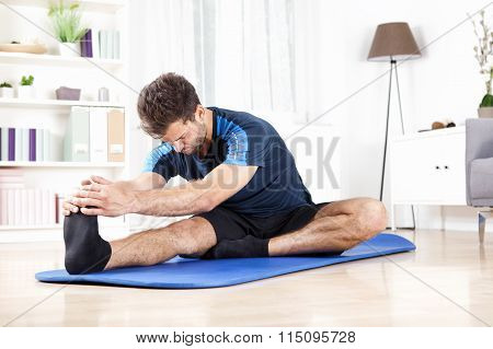 Man Doing Hamstring Stretch On Top Of A Mat