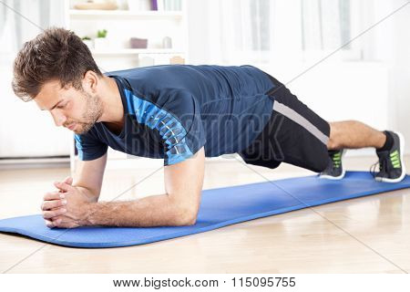 Fit Man In Planking Exercise Facing The Floor