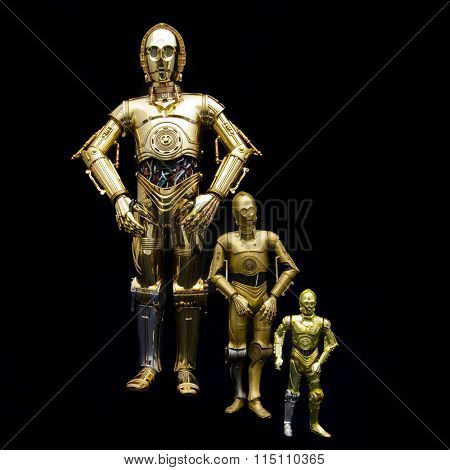 BLOOMFIELD NJ - JAN 17, 2016: Portrait of 3 sizes of Star Wars C3PO action figures: 12, 6 & 3.75 inches. C3PO is played by Anthony Daniels and has appeared in all Star Wars movies, episodes 1 through 7.