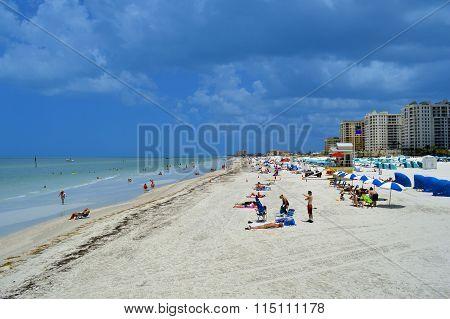 Tourists on the beach enjoying the sun