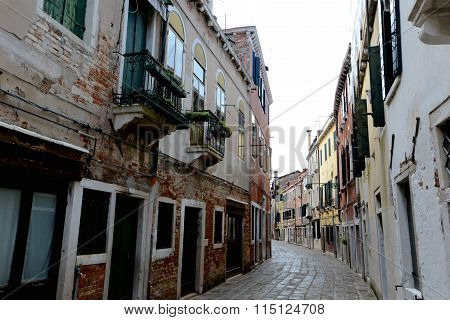 Empty Venetian Street Curves Away From Camera