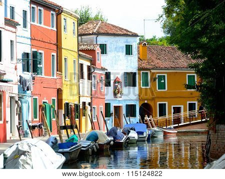 Row Of Colorful Boats And Buildings In Burano Venice, Italy