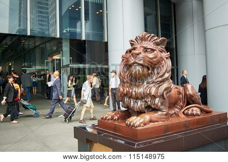 HONG KONG - MAY 06, 2015: Right lion statues of HSBC Main Building. HSBC Holdings plc is a British multinational banking and financial services company headquartered in London, United Kingdom.