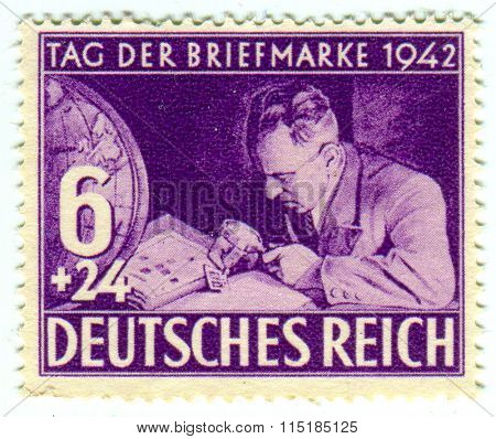 GOMEL,BELARUS - JANUARY 2016: A stamp printed in Germany shows image of the German philatelists, circa 1942.