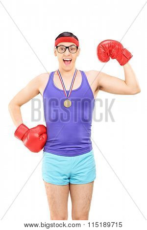 Vertical shot of a geeky guy with red boxing gloves wearing a medal isolated on white background