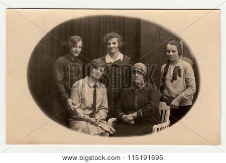 Vintage photo shows girls with teacher circa 1930.