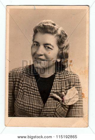 Vintage studio photo of young woman circa 1935.