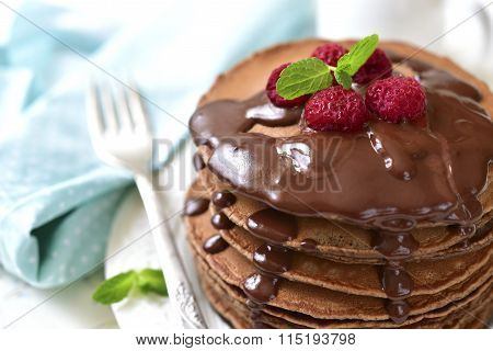 Chocolate Pancakes With Raspberry And Chocolate Sauce.