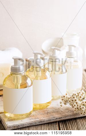 Liquid Soaps On Wooden Table