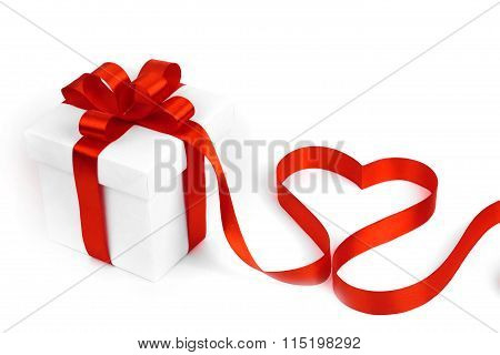White boxes with red ribbons and decorative heart