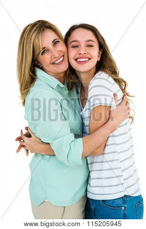 Mothers and daughter embracing merrily